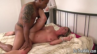 White wife licking black man's penis and face