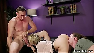 Dominatrix woman screws a guy in front of the guy